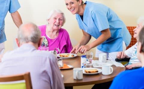 elderly dinning with their caregiver